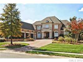 This five bedroom estate is located in a gated community in Waxhaw. The home is priced at $1,497,000.