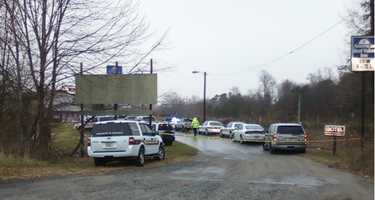 Several law enforcement vehicles responded to the scene of a standoff at a hotel in Jonesville. (David Efird/WXII)