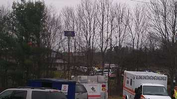 The large, interstate-visible hotel sign from behind the police line (William Bottomley/WXII)