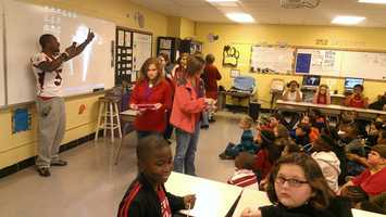 """WSSU wide receiver Tehvyn Brantley gets ready to play """"Are you smarter than a 4th grader?"""" at Wilson Elementary School in Sheffield, Ala. (Kenny Beck/WXII)"""