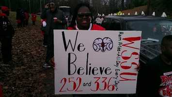 """A fan holds up a sign that says """"We believe,"""" the team's mantra. (Kenny Beck/WXII)"""
