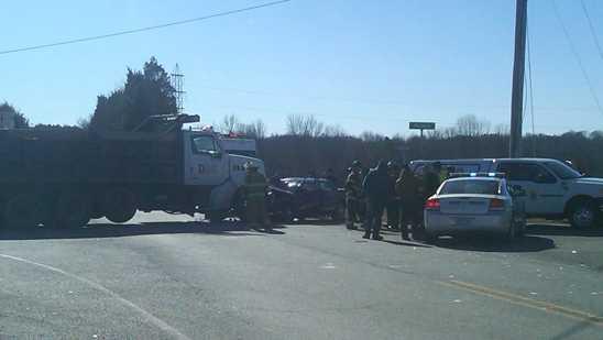 Dump truck, car collide in Davidson County