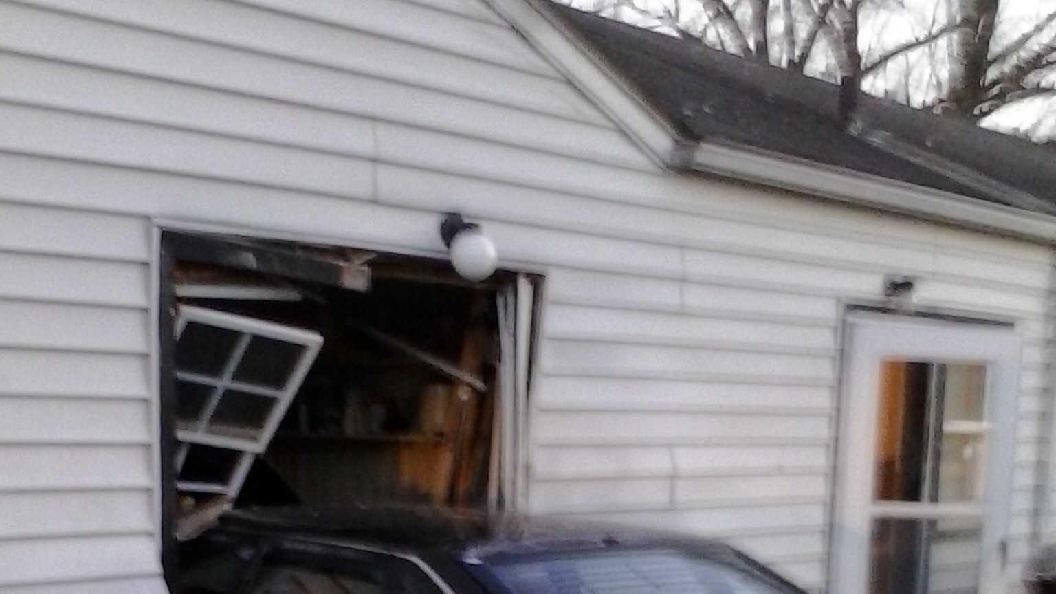 Car hits building