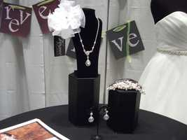 Bridal Traditions Wedding and Prom Attire even had some jewelry from their store in the booth.