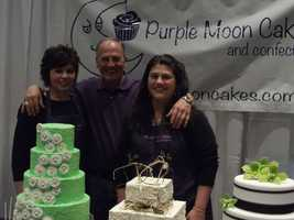 Purple Moon Cakes and Confections were represented well at the wedding show. They had signs for each cake that told the number of people served and prices.