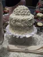 Kathy's Kreations Bakery & Confectionary Gift Shop made this elegant white cake for your reception. Email: murphy@skybest.com.