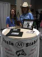 Circle M Stables was present to talk to couples about the transportation they offered.