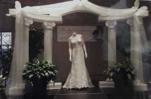 Click here for Cherished Moments Weddings and Events had photo albums to show some of her work. This archway she made in 2012's Bridal Traditions Expo.
