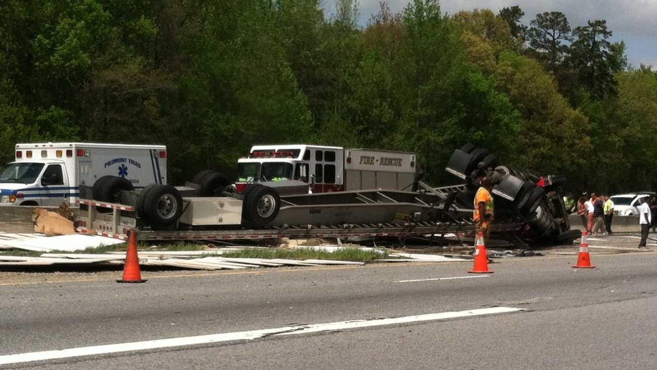 Tractor-trailer overturns 041813