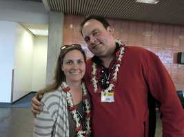 Angela and Austin make it to the airport in Hawaii and receive Hawaiian leis upon arrival.