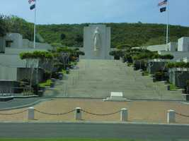 "The National Memorial Cemetery of The Pacific walls of the memorial are etched with names of 28,788 military personnel who are missing in action or were lost or buried at sea in the Pacific flank the Memorial's grand stair case. The slabs with the names are called the ""Courts of Missing."""