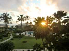 Pacific sunset starts over the hotel begins in Maui.