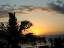 Enjoy this sunset over Maui with the roaring ocean tide.