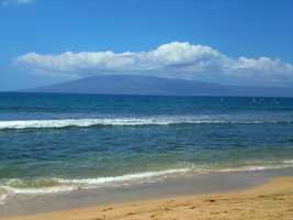 The travelers relax on the beautiful Maui beaches during their tour of the Hawaiian Islands.