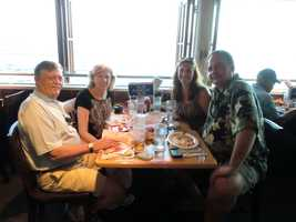 """Austin, Angela, Louie and Geraline enjoying some food from the Bubba Gump Restaurant in Lahaina. (See the """"Run Forest Run"""" sign?)"""