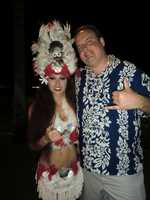 The entertainer at the Luau in Maui has festive headgear and clothing on for the dancing and show.