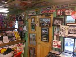Look at all the walls, on the ceiling, behind the counter. Some famous race car drivers eat here and have left pictures to prove the love of the hot dogs.