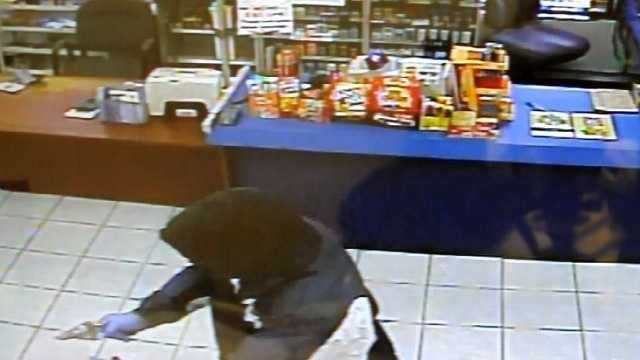 Surveillance image of Buncombe County convenience store robbery
