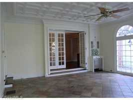 Sunroom with tile flooring