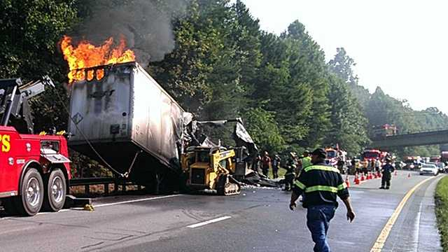 This trailer carrying oil-based air freshener suddenly caught fire along I-77 in Surry County.