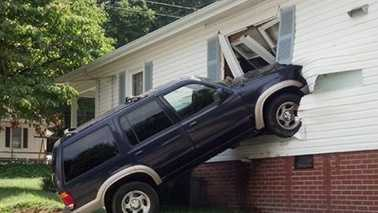 SUV hits home 6 feet above ground