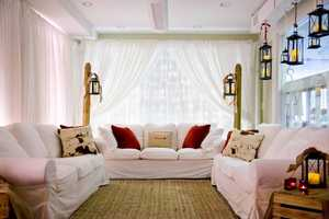 One of the decorated rooms for the wedding. This would be a room for the future bride and bridesmaids to relax before getting ready for the wedding. (Billie Buskirk Photography.com)