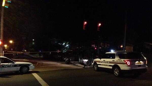 Police say a gunman has been shot and killed near the campus of North Carolina Central University in Durham.