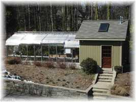 State of the art Green House with potting areas, automatic vents and heaters.