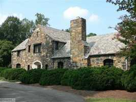 This six bedroom Tudor Revival Manor is listed on the National Registry and priced at $1,550,000