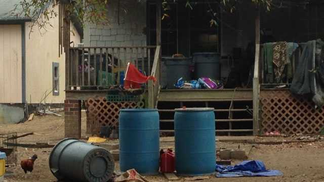 Foster child handcuffed to porch
