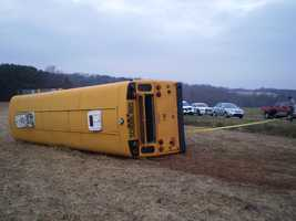 Students were among roughly a dozen people taken to hospitals after a school bus overturned in Yadkin County Tuesday morning.