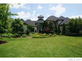 This Mooresville estate has over 8000 sq. ft. and is priced at $3,000,000. The home features a wet bar and wine cellar, home theater and gym.