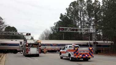 Train, car collide in Cary