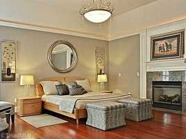 Master Bedroom Suite with a fireplace and brazilian cherry hardwood floors.