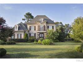 This five bedroom Raleigh estate is priced at $1,285,000. The home features a beautiful great room with a vaulted beamed ceiling, a gourmet kitchen with breakfast area and a screened porch with fireplace.