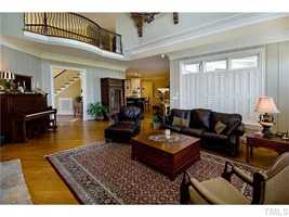 Two-Story Great Room with vaulted beamed ceiling