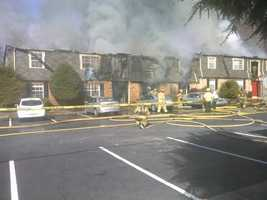 Submitted by u local mobile user in front of the burning apartments.