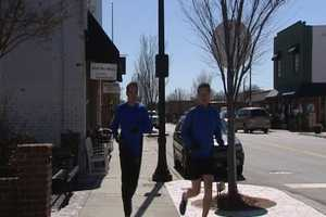 "The town manager is Curtis Swisher, seen here on a running tour of Kernersville with Cameron Kent. Swisher's father is well known Bowman Gray driver Melvin ""Puddin"" Swisher."
