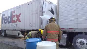 Hazmat crews were called to the scene because of a fuel spill.