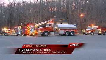 Firefighters battled five building fires within 12 miles of each other in Randolph County Monday morning.