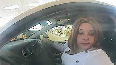 Surveillance image of car break-in, bank fraud suspect