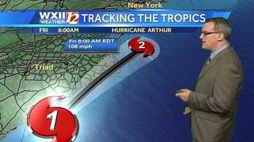 The latest National Hurricane Center forecast track had Arthur's eye turning northeast, gaining speed and crossing very close to the Outer Banks as a Category 2 storm Thursday night into early Friday morning.