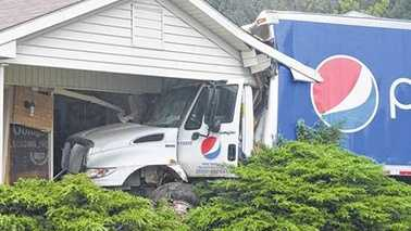 Pepsi truck crashes into home in Galax