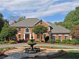 This five bedroom lake front property is located in Lewisville and priced at $1,197,000.