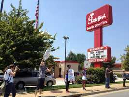 "This is the day that's been designated by supporters of the Chick-fil-A restaurant chain as an ""appreciation day"".  The following images are from locations across the country."