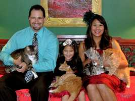 This is weekend anchor Myra Ruiz and her husband and daughter with (left to right) Pizarro, Sherpa, Rose Bunny (named by Myra's daughter) and Corby.