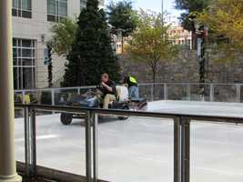 Workers keep the ice smooth for skaters