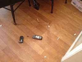 One bullet shattered a cell phone.