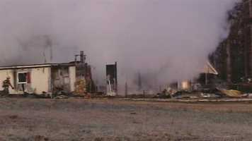 A Pickens County couple woke up to the smell of smoke early Thursday, turning into a fire that burned their home inside a huge barn. Click through to see images of the fire.