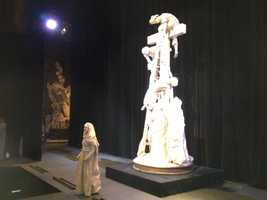"""Director Paul Radford said, """"The Living Gallery focuses on what the characters in the art would say if they could speak. The characters include the kneeling centurion from Rembrandt's The Three Crosses, Mary the mother of Christ from Michelangelo's Pieta, and Judas Iscariot from DaVinci's Last Supper. The drama is set during the dark window of time between the Crucifixion and the Resurrection, when all were unaware that Christ's triumph over death was just moments away."""""""